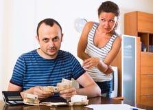 Sad couple counting budget Royalty Free Stock Photos