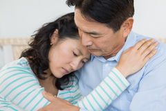 Sad couple embracing Royalty Free Stock Image