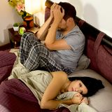 Sad couple after fight in bed Stock Images