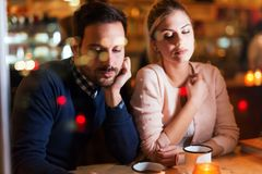 Sad couple having conflict and relationship problems. Sitting in bar Stock Photography