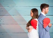 Sad couple holding broken heart Royalty Free Stock Photos
