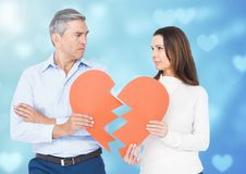 Sad couple holding broken heart Stock Images