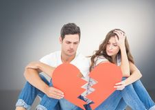 Sad couple holding broken hearts stock images