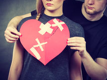 Sad couple holds broken heart. Stock Images