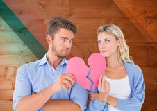 Free Sad Couple Looking Each Other While Holding Broken Hearts Stock Photography - 85229212