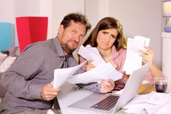 Sad couple showing taxes looking camera Royalty Free Stock Photos