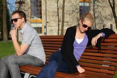Sad couple sitting in park Royalty Free Stock Photos