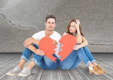Sad couple sitting together with broken hearts Stock Photos
