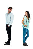 Sad couple standing back to back. Not talking after argument on white screen Stock Images