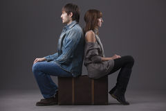 Sad couple with suitcase Stock Photography