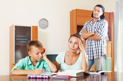 Sad couple with underachiever teenage boy doing homework Royalty Free Stock Photography