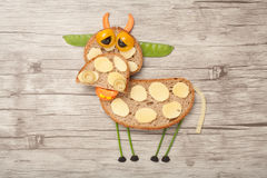 Sad cow made of bread and vegetables Royalty Free Stock Photography