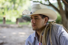 Sad cowboy. With lasso on shoulders Royalty Free Stock Photography