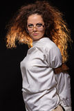 Sad crazy woman. In glasses at dark Royalty Free Stock Images