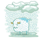 Sad creature. Standing in the rain Royalty Free Stock Images