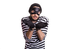 Sad criminal with handcuffs. Portrait isolated on white background Stock Photos