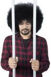 Sad criminal in prison Stock Photo
