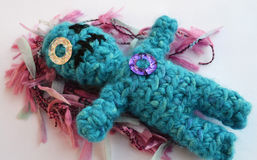 Sad crochet doll with scar. Sad and abandoned crochet doll with a scar on her mouth and eye Royalty Free Stock Photography