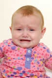 Sad crying baby Stock Photos