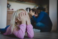 Sad crying bored child, tired and exhausted mother royalty free stock photography