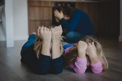 Sad crying bored kids, tired and exhausted mother. Difficult parenting royalty free stock photography