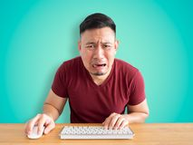 Sad and crying face of man working in office. Sad and crying face of Asian man who failed his work Stock Image