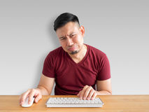 Sad and crying face of man working in office. Sad and crying face of Asian man who failed his work Royalty Free Stock Photo