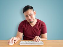 Sad and crying face of man working in office. Sad and crying face of Asian man who failed his work Stock Photography