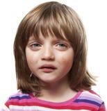 Sad crying little girl. Crying little girl - white background Stock Photo