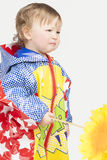 Sad and crying little girl in raincoat Stock Photography