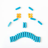 Sad and crying smile made from many pills capsules. wellness concept Royalty Free Stock Photography