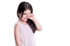 Sad crying unhappy small beautiful girl with dark hair and eyes. Royalty Free Stock Photos