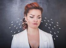 Sad crying woman on blackboard background stock image