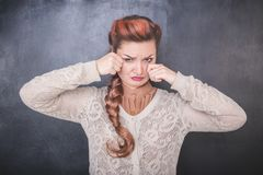 Sad crying woman on the chalkboard background stock photography