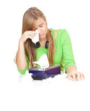 Sad, crying young woman with tissues Royalty Free Stock Photography