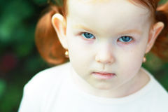 Sad curly little girl Stock Images