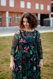 Sad curvy girl with curly hair in the street Royalty Free Stock Images