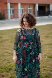 Sad curvy girl with curly hair in the street Royalty Free Stock Photo