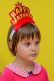 Sad cut little birthday girl.  Stock Photo