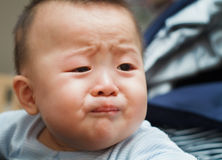 Sad cute asian baby watching out Royalty Free Stock Photography