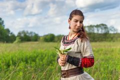 Sad cute farmgirl looking back on a summer field Royalty Free Stock Photo
