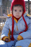 Sad cute girl. Little caucasian girl in winter clothes with sad facial expression gazing Stock Photography