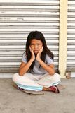 Sad cute homeless child royalty free stock photo