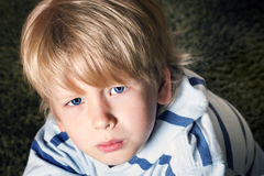 Sad cute little blonde boy Royalty Free Stock Photography