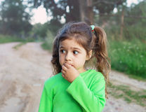 Sad cute little girl looking sad and afraid Royalty Free Stock Image
