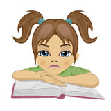 Sad cute schoolgirl keeping her arms on open book. On white background Royalty Free Stock Photos