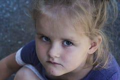 Sad cute young caucasian girl. Portrait of a sad cute young caucasian girl Royalty Free Stock Photos