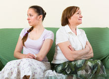 Sad daughter against  mother Royalty Free Stock Photo