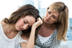 Sad daughter against mother Stock Image