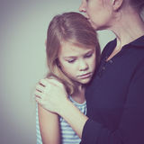Sad daughter hugging his mother. At home. Concept of couple family is in sorrow stock photo